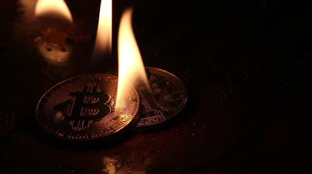 The fire is on the gold and silver bitcoins like a candle.