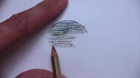 načmárat : The dashed line on the reverse side of a bitcoin with a colored pencil.