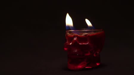 romsvetnik : Halloween glass skull with red liquid on fire. Footage for Halloween for witches or extrasensory. Stock Footage