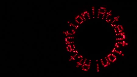 romsvetnik : Glowing red inscription Attention! moves in a circle on a black background.