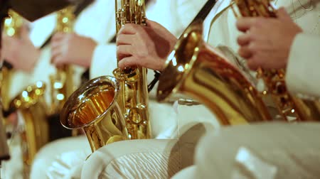 jazz festival : Saxophonists in white suits play a jazz part. Small DOF.