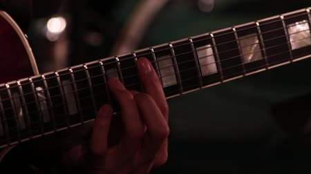 rock festival : A male hand while playing an electric guitar. Close-up. Footage on a musical theme. Stock Footage