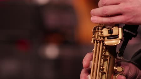 flutist : Close-up part of a woodwind instrument soprano saxophone while playing music. Stock Footage