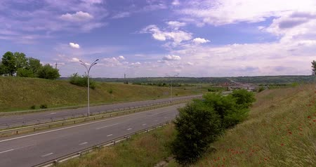 ограждение : the highway. car and truck moves at great speed at the sunny day near the poppy field