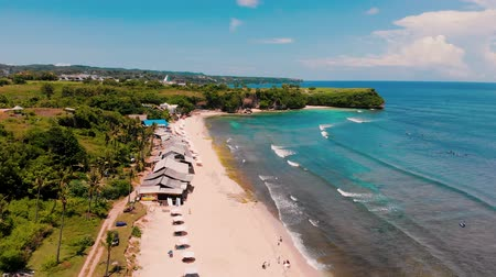 shores : Aerial view of beach and cliff taken at Balangan beach of Bali, Indonesia