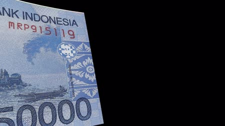 Indonesia banknote Wiper Video Effect simulates Indonesia Money banknote Transition from left to right with alpha channel Stock Footage