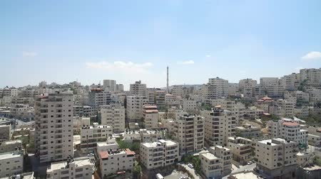 palestina : Flying over Palestinian town and mosque  Aerial view of Anata Palestinian town on the border at east jeruslaem and the security wall Stock Footage