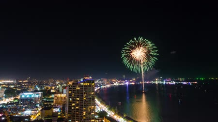 CHONBURI - NOVEMBER 29: Timelapse view of fireworks on the beach of Pattaya city on November 29, 2013 in Chonburi, Thailand.