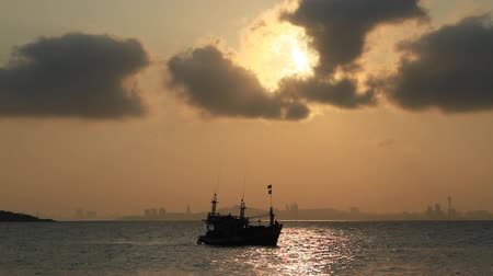 Fishing boat on the sea in sunrise, Thailand