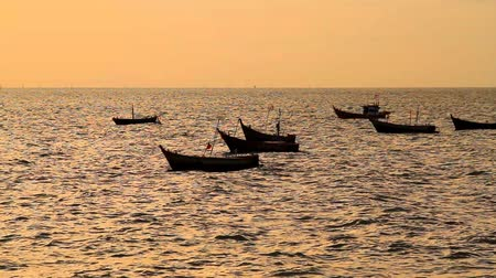 Fishing boats on the sea in sunset, Thailand