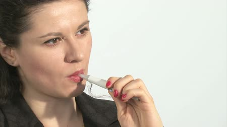 cigarettes : Youg woman smoking an electronic cigarette