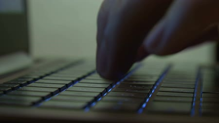 presleme : Male hand typing on illuminated keyboard Stok Video