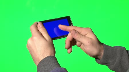 dokunaklı : Man using smartphone with a blue screen to add your own custom content