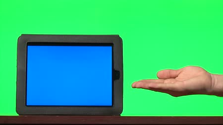 жест : Man presenting digital tablet with a blue screen and gesturing: pointing, countdown from five, hand shooting Стоковые видеозаписи