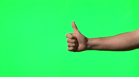 polegar : Male hand gestures on green screen: presenting, pointing, thumbs up, snapping, clapping