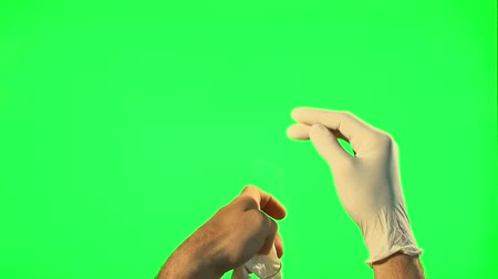 pulling off : Man take off and puts on his surgical gloves - green screen Stock Footage