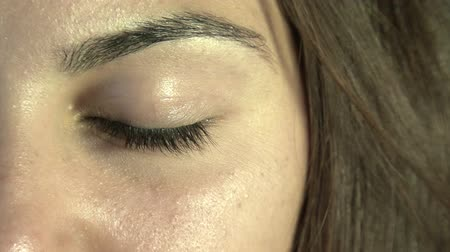 eyes closed : Close-up of womans eye Stock Footage