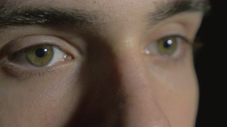eyes closed : 4k UHD - Close-up of a young man eyes opening and blinking
