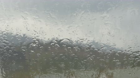 rainy : Closeup of the rain pouring on the window Stock Footage