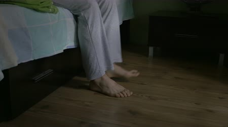 morning : Close-up of man feet getting out of bed