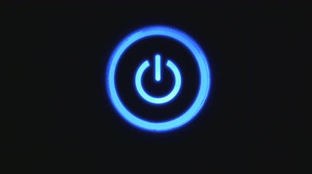 turning off : Power button turning on and off on a dark background Stock Footage