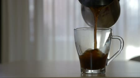 black coffee : Pouring hot coffee in a transparent mug in the morning in slow motion
