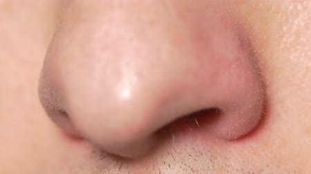 smell : Close-up of male nose sniffing