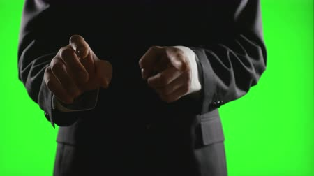 újító : Young businessman making hand gestures in a virtual business environment on green screen