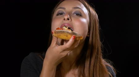 italian speciality : Closeup of beautiful woman enjoying a slice of her favorite pizza
