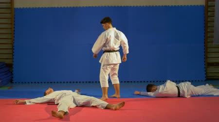 quimono : Karate fighters practicing attack and blocking techniques at the dojo