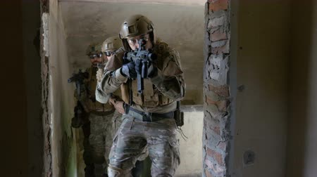 special unit : Special forces terrorist hunter unit searching abandoned building for their military target Stock Footage
