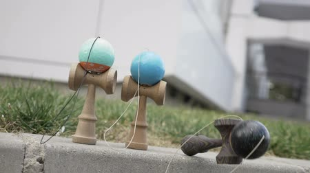 collectable : Slow motion of kendama toys being blown away by the wind