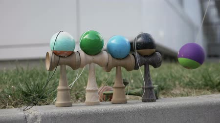 collectable : Kendama toys being hit with colored ball and falling down in slow motion