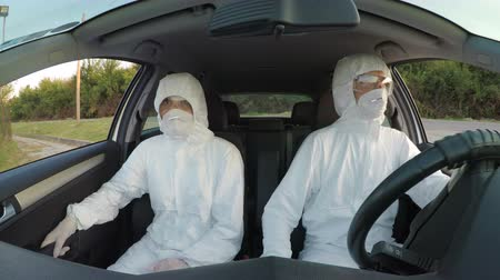 bacteriological : Engineers in hazmat suits driving to their rescue mission