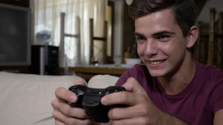 playstation : Concept of extreme video gaming addiction playful teenager at home pushing controller keys trying winning competitive game