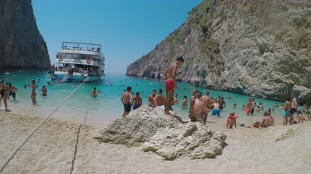 zakynthos : GREECE, ZAKYNTHOS AUGUST 2017: Beach full of tourists enjoying their summer holiday diving and swimming in a natural pool