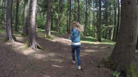 honit : Scared young girl running away to escape from danger through mountain forest