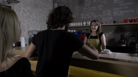 clothes line : Clients waiting in line in a modern cafe shop to be served and pay with a new technology implemented on their mobile smartphones app Stock Footage