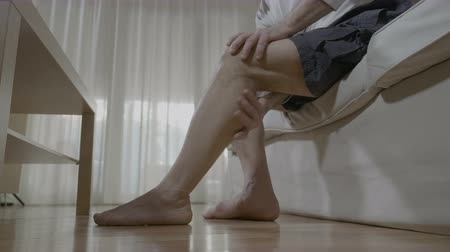 relieve : Senior man doing himself massage therapy on his tired legs relieve the pain and stress at home
