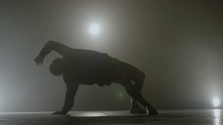 hiphop : Teenage student performing a sensitive sensual modern dance in front of a smoke background