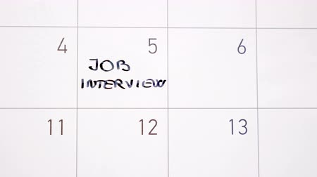 Animation writing job interview marking the day in calendar with black ink