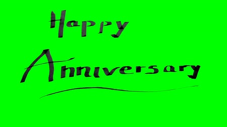 Green screen animation calligraphy writing happy anniversary with black ink on paper