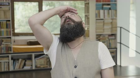 facepalm : Young man with beard having a face palm facepalm reaction and expressing sarcasm