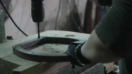 hangar : Woman worker using a drilling to make holes in a piece of metal in her diy workshop Stock Footage
