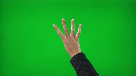 indicating : Close up of young woman hands counting backward from five to one on green screen background Stock Footage