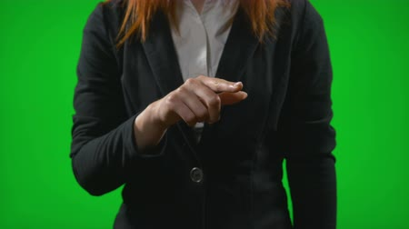 imaginário : Young woman in business wear working with holographic interface gesturing with hands sliding and zooming the desktop contents Stock Footage