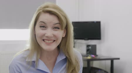 удивительный : Beautiful cheerful young business woman having a happy reaction being surprised by great news at office