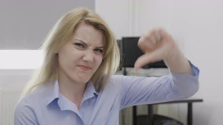 refusing : Disgusted young businesswoman showing thumbs down sign of dislike