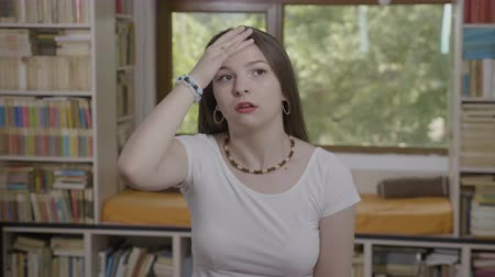 unlucky : Teenage woman slapping her face gesturing facepalm expressing exasperation and annoyance Stock Footage