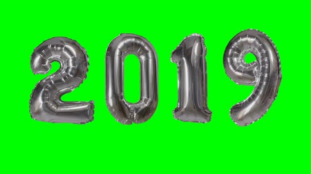 yeni : Number 2019 happy new year birthday anniversary celebration silver balloon floating on green screen background